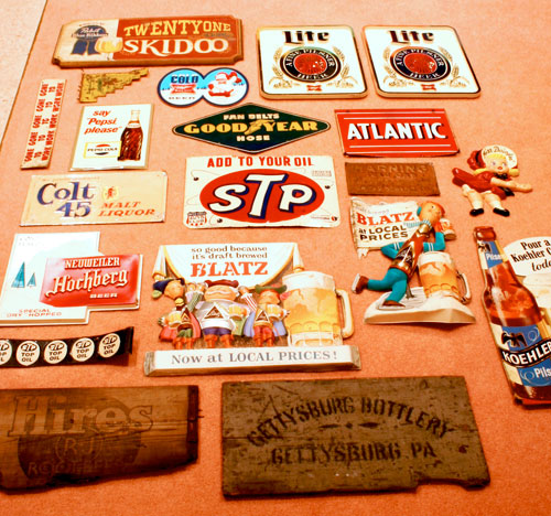 vintage oil, gas, and beer signs