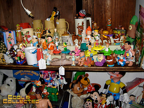 dc big flea - shelf of collectible toys