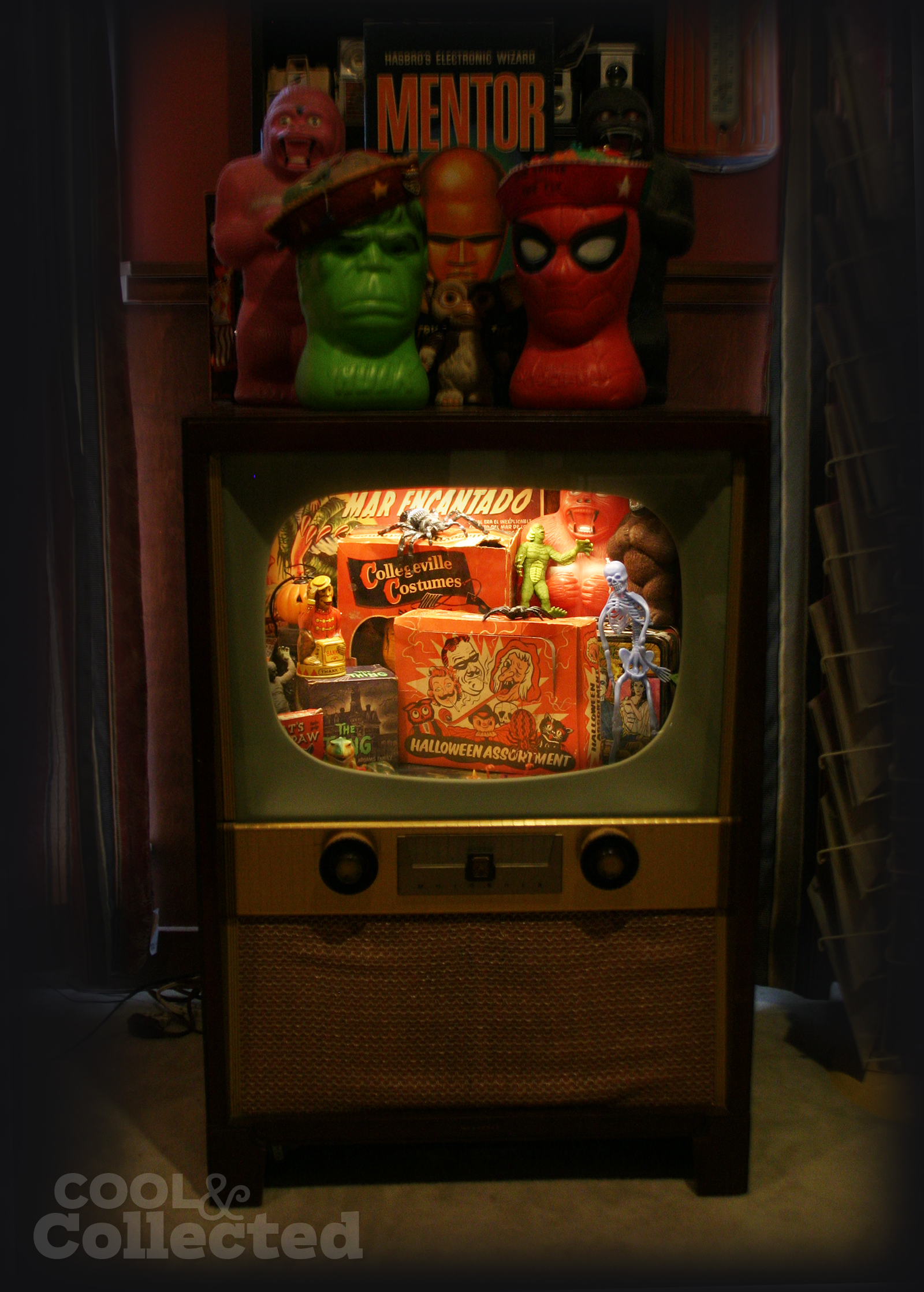 Vintage Halloween collection displayed in a retro TV cabinet