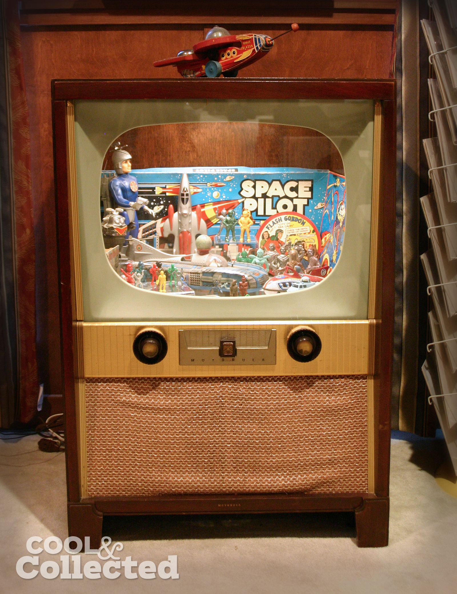 Vintage space toys on display in a converted vintage television console