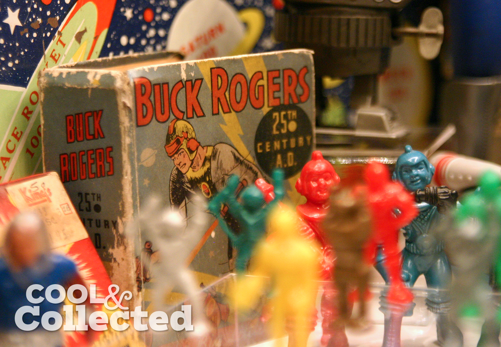 Vintage Buck Rogers Big Little Book with other space themed toys